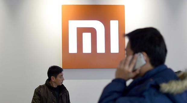 Phone maker vows to cap profits ahead of $100bn IPO