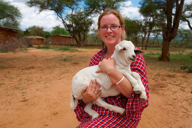 Paula Hynes pictured with a kid goat in Kenya
