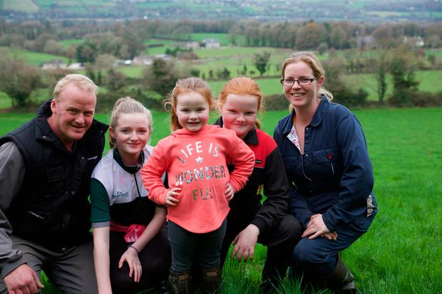 Happy family: Paula and Peter Hughes with their daughters Chloe (14), Becky (11) and Georgie (four) at home on their Co Cork farm