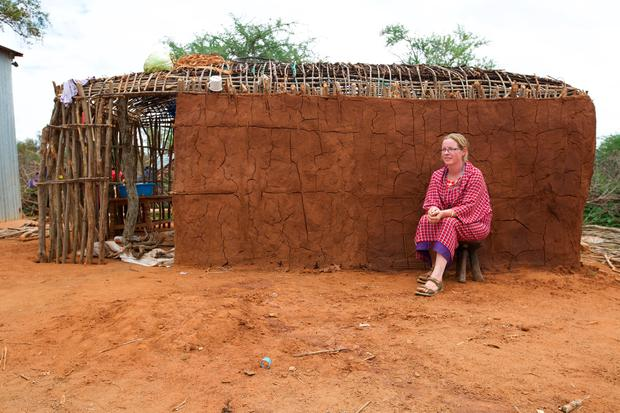 Home from home: Paula in front of a manyatta mud hut