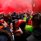 Fans outside Anfield before the first leg