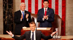French President Emmanuel Macron, applauded by US Vice President Mike Pence, left, and Speaker Paul Ryan, arrives to address a joint meeting of Congress in Washington. Photo: Reuters
