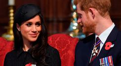 Britain's Prince Harry (R) and his US fiancee Meghan Markle attend a service of commemoration and thanksgiving to mark Anzac Day in Westminster Abbey in London on April 25, 2018