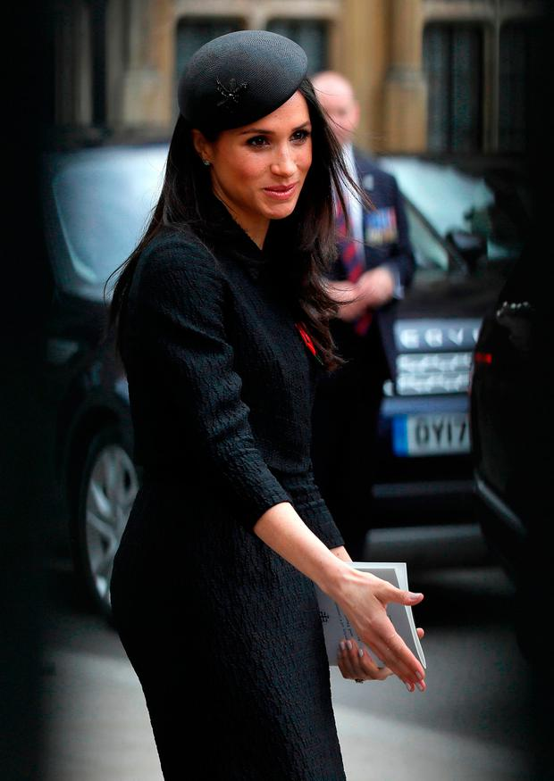 The US fiancee of Britain's Prince Harry, Meghan Markle, leaves after attending a service of commemoration and thanksgiving to mark Anzac Day in Westminster Abbey in London on April 25, 2018