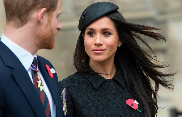 Britain's Prince Harry (L), his US fiancee Meghan Markle (C), and Britain's Prince William, Duke of Cambridge, attend a service of commemoration and thanksgiving to mark Anzac Day in Westminster Abbey in London on April 25, 2018