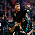 Real Madrid's Marcelo celebrates scoring their first goal with Sergio Ramos and Isco