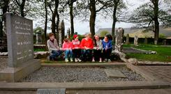 Alice Lyons reading poetry to a group of schoolchildren at Yeats's grave in Sligo Photo: Brian Farrell