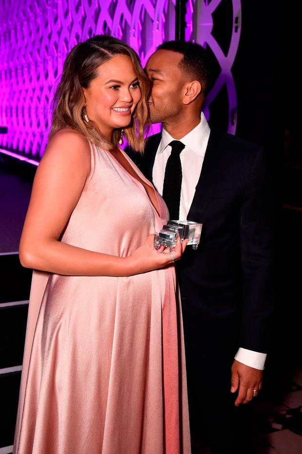Chrissy Teigen (L) and John Legend attend City Harvest's 35th Anniversary Gala at Cipriani 42nd Street on April 24, 2018 in New York City. (Photo by Bryan Bedder/Getty Images for City Harvest)