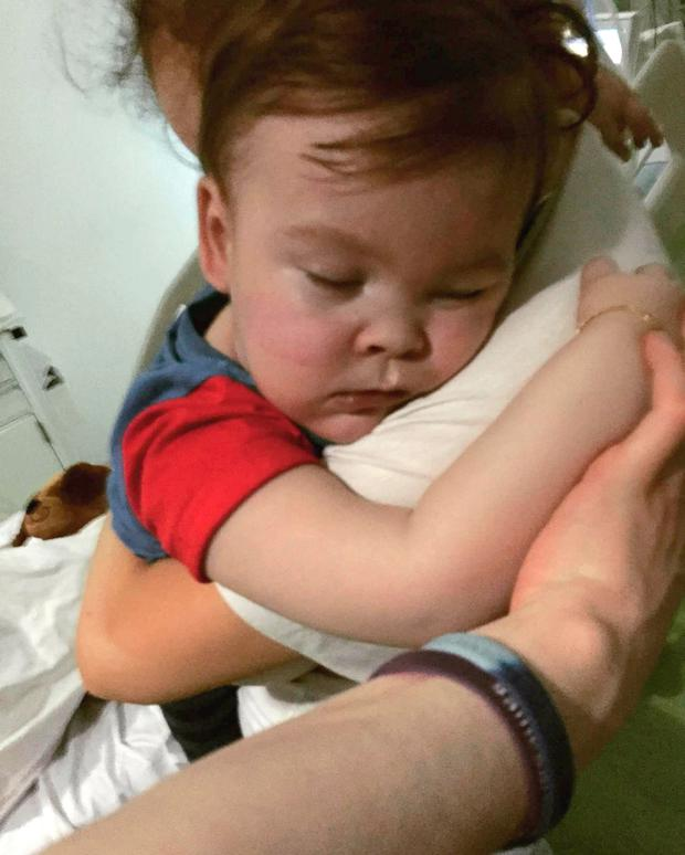 Alfie Evans cuddling his mother Kate James at Alder Hey Hospital, Liverpool. Photo: Alfies Army Official/PA Wire