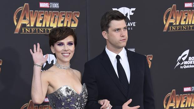 Saturday Night Live's Colin Jost, pictured with Scarlett Johansson, will host this years Emmys with his SNL co-star Michael Che (Photo by Jordan Strauss/Invision/AP)