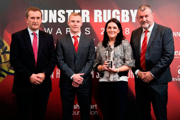 Munster CEO Garrett Fitzgerald, player of the year Keith Earls and team manager Niall O'Donovan present the Hall of Fame award to Olive Foley on behalf of her husband Anthony