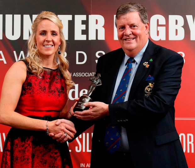 Munster Association of Referees president Brian Keating presents Joy Neville with the referee of the year award