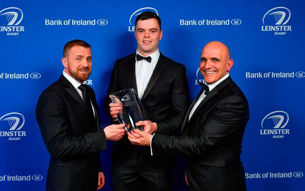 James Ryan receiving the Laya Healthcare Young Player of the Year award from deputy managing director D.O. O'Connor of Laya Healthcare and Leinster Rugby president Niall Rynne. Photo: Brendan Moran/Sportsfile