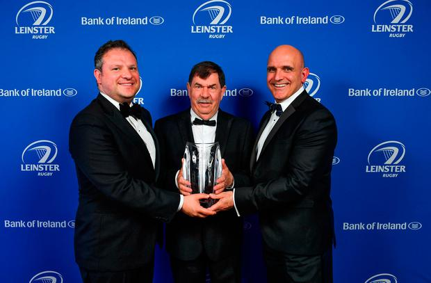 Mullingar RFC's Hugh Woodhouse picks up the Beauchamps Contribution to Leinster Rugby award from Beauchamps managing partnerJohn White (left) and Niall Rynne. Photo: Brendan Moran/Sportsfile