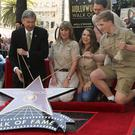 Steve Irwin's family and friends at a ceremony honouring him with a star on the Hollywood Walk of Fame (Willy Sanjuan/AP)