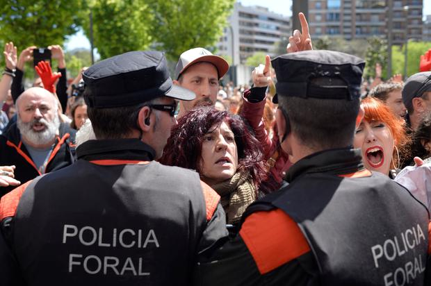 Protesters break through a police line after a nine-year sentence was given to five men accused of the multiple rape of a woman during Pamplona's San Fermin festival in 2016, in Pamplona, Spain, April 26, 2018. REUTERS/Vincent West