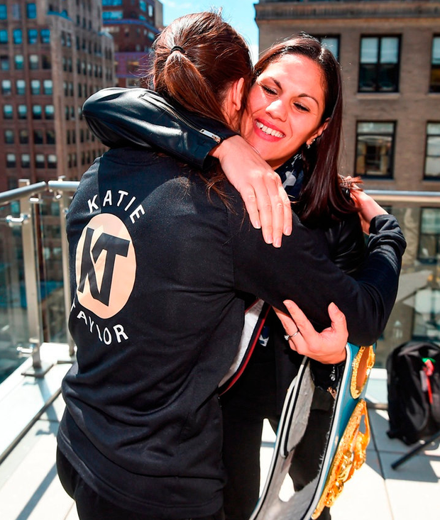 Katie Taylor and Victoria Bustos embrace after yesterday's press conference at Mondrian Park Avenue in New York. Photo: Stephen McCarthy/Sportsfile