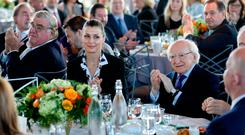 President Michael D Higgins is joined by Bridget Moynahan – an American actress and model who stars in the television series 'Blue Bloods' – at the Ireland Funds breakfast event held yesterday in the Rockefeller Centre in New York. Photo: Maxwells