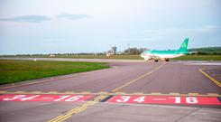 The first flight after the renaming of the main runway at Cork Airport prepares to take off. Photo: Brian Lougheed