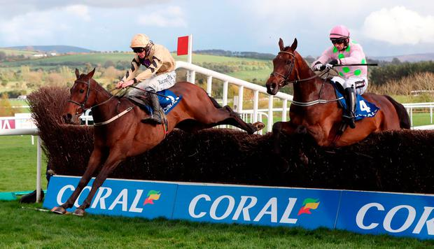 Bellshill ridden by David Mullins (left) jumps the last ahead of Djakadam ridden by Patrick Mullins to win the Coral Punchestown Gold Cup at the Punchestown Festival. Photo: Niall Carson/PA