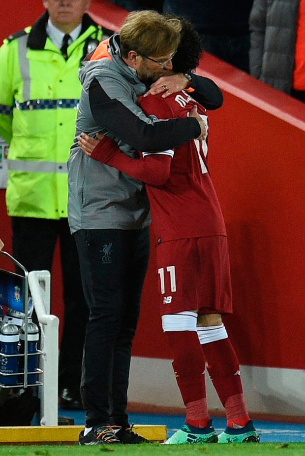 Liverpool's manager Jurgen Klopp embraces Mohamed Salah. Photo: Getty Images