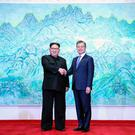 South Korean President Moon Jae-in shakes hands with North Korean leader Kim Jong Un during their meeting at the Peace House at the truce village of Panmunjom inside the demilitarized zone separating the two Koreas, South Korea, April 27, 2018. Korea Summit Press Pool/Pool via Reuters