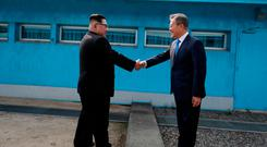 South Korean President Moon Jae-in shakes hands with North Korean leader Kim Jong Un during their meeting at the truce village of Panmunjom inside the demilitarized zone separating the two Koreas, South Korea, April 27, 2018. Korea Summit Press Pool/Pool via Reuters