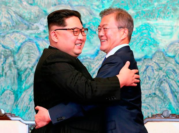 Kim Jong-un (left) and Moon Jae-in (right) at the meeting. Photo: AP