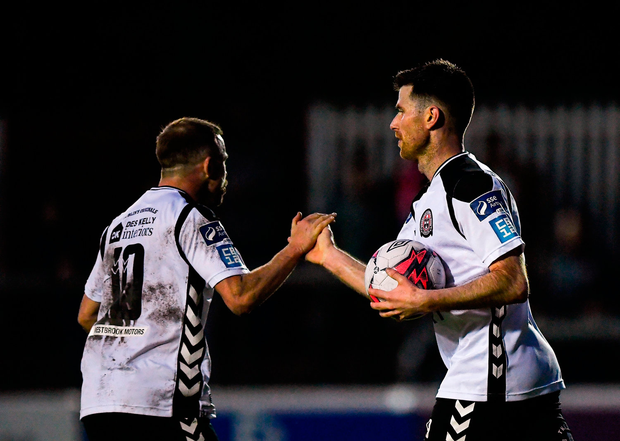 Dinny Corcoran, right, of Bohemians is congratulated by team-mate Keith Ward