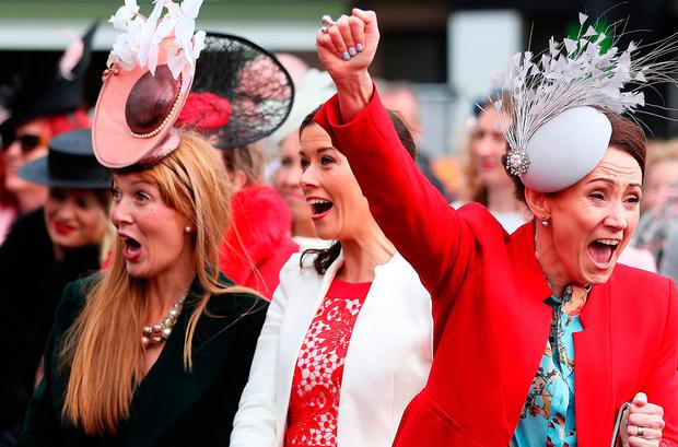 Racegoers celebrate the results of the Best Dressed Lady competition at Punchestown Photo: Brian Lawless/PA Wire
