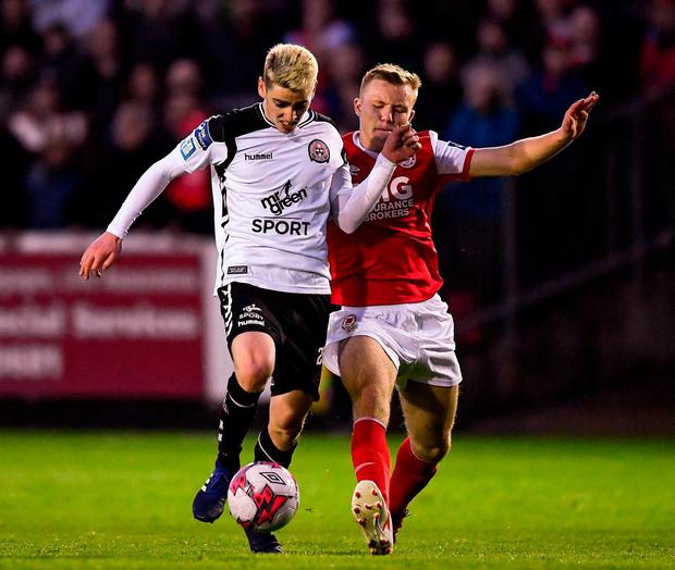 Bohemians' Dylan Watts in action against St Patrick's Athletic's Jamie Lennon. Photo: Seb Daly/Sportsfile