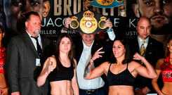 Katie Taylor, left, and Victoria Bustos square off after weighing in