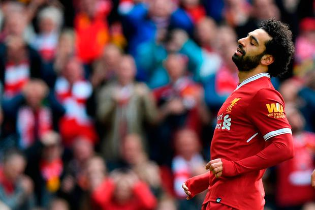 Liverpool's Egyptian midfielder Mohamed Salah reacts to missing a shot at goal during the English Premier League football match between Liverpool and Stoke City at Anfield in Liverpool, north west England on April 28, 2018. / AFP PHOTO / Paul ELLIS