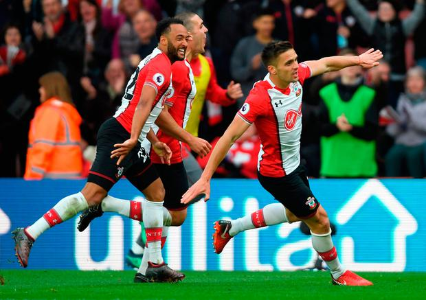 SOUTHAMPTON, ENGLAND - APRIL 28: Dusan Tadic of Southampton celebrates scoring his side's second goal with Nathan Redmond and Oriol Romeu during the Premier League match between Southampton and AFC Bournemouth at St Mary's Stadium on April 28, 2018 in Southampton, England. (Photo by Mike Hewitt/Getty Images)