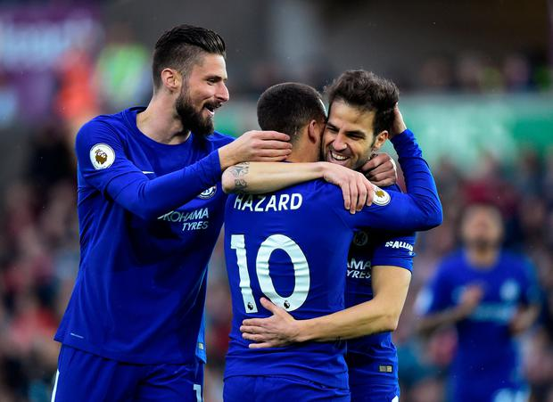 Soccer Football - Premier League - Swansea City v Chelsea - Liberty Stadium, Swansea, Britain - April 28, 2018 Chelsea's Cesc Fabregas celebrates scoring their first goal with Eden Hazard and Olivier Giroud REUTERS/Rebecca Naden