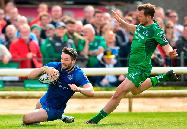 Barry Daly crosses the line for Leinster despite the tackle of Connacht's Jack Carty. Photo: Ramsey Cardy/Sportsfile