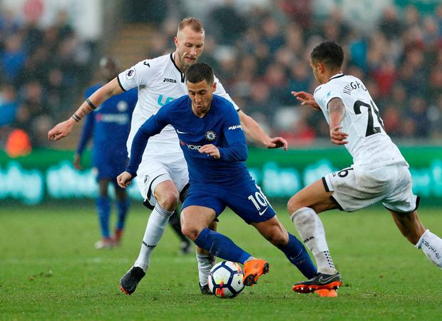 Chelsea's Eden Hazard runs at the Swansea City defence during his side's victory at the Liberty Stadium yesterday. Photo: John Sibley/Action Images via Reuters