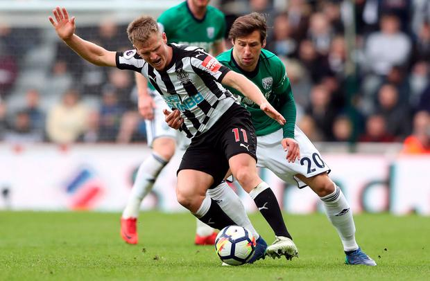 Newcastle United's Matt Ritchie in action with West Bromwich Albion's Grzegorz Krychowiak. Photo: Scott Heppell/Reuters