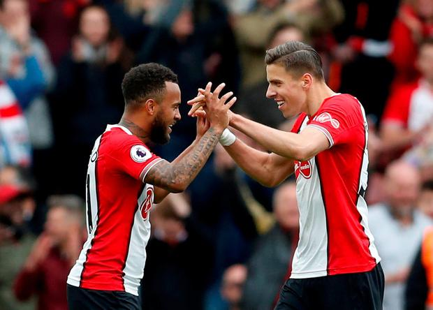Southampton's Nathan Redmond and Jan Bednarek celebrate after the match. Photo: Matthew Childs/Action Images via Reuters
