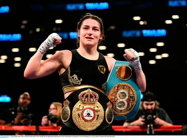 Katie Taylor celebrates following her WBA and IBF World Lightweight unification bout with Victoria Bustos