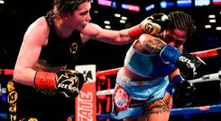 Katie Taylor, left, and Victoria Bustos during their WBA and IBF World Lightweight unification bout at the Barclays Center in Brooklyn, New York. Photo by Stephen McCarthy/Sportsfile