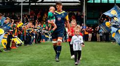 WORCESTER, ENGLAND - APRIL 28: Donncha O'Callaghan of Worcester Warriors walks out onto the pitch, with his children, before retiring from rugby union during the Aviva Premiership match between Worcester Warriors and Harlequins at Sixways Stadium on April 28, 2018 in Worcester, England. (Photo by David Rogers/Getty Images)