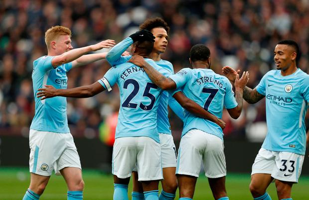 Manchester City's Fernandinho celebrates scoring their fourth goal with teammates