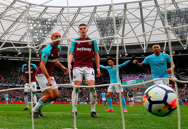 Declan Rice reacts to scoring a own goal. Photo: Catherine Ivill/Getty Images