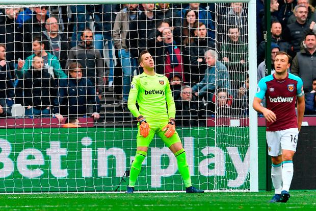West Ham goalkeeper Adrian reacts after a deflected shot from Leroy Sane beats him for the opening goal. Photo: AFP/Getty Images