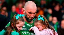 Connacht's John Muldoon leaves the field with his nieces Emma and Lily after Saturday's victory against Leinster. Photo: Brendan Moran/Sportsfile