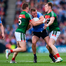 Ciarán Kilkenny of Dublin is tackled by Lee Keegan, left, and Donal Vaughan of Mayo