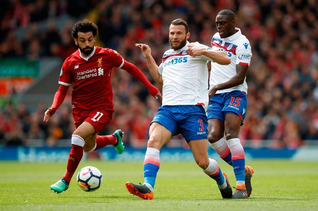 Soccer Football - Premier League - Liverpool v Stoke City - Anfield, Liverpool, Britain - April 28, 2018 Liverpool's Mohamed Salah in action with Stoke City's Erik Pieters and Bruno Martins Indi. Action Images via Reuters/Carl Recine.