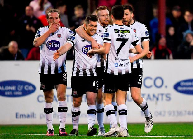Ronan Murray celebrates with teammates after extending Dundalk's lead. Photo: Harry Murphy/Sportsfile
