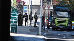 Gardaí and Army bomb disposal team members at Connolly Station after workers found explosives. Photo: Mark Condren
